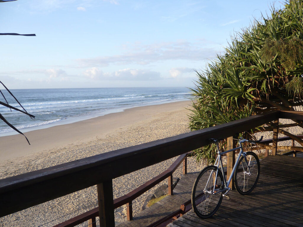 bicycle tour in front of Sunshine Coast beach