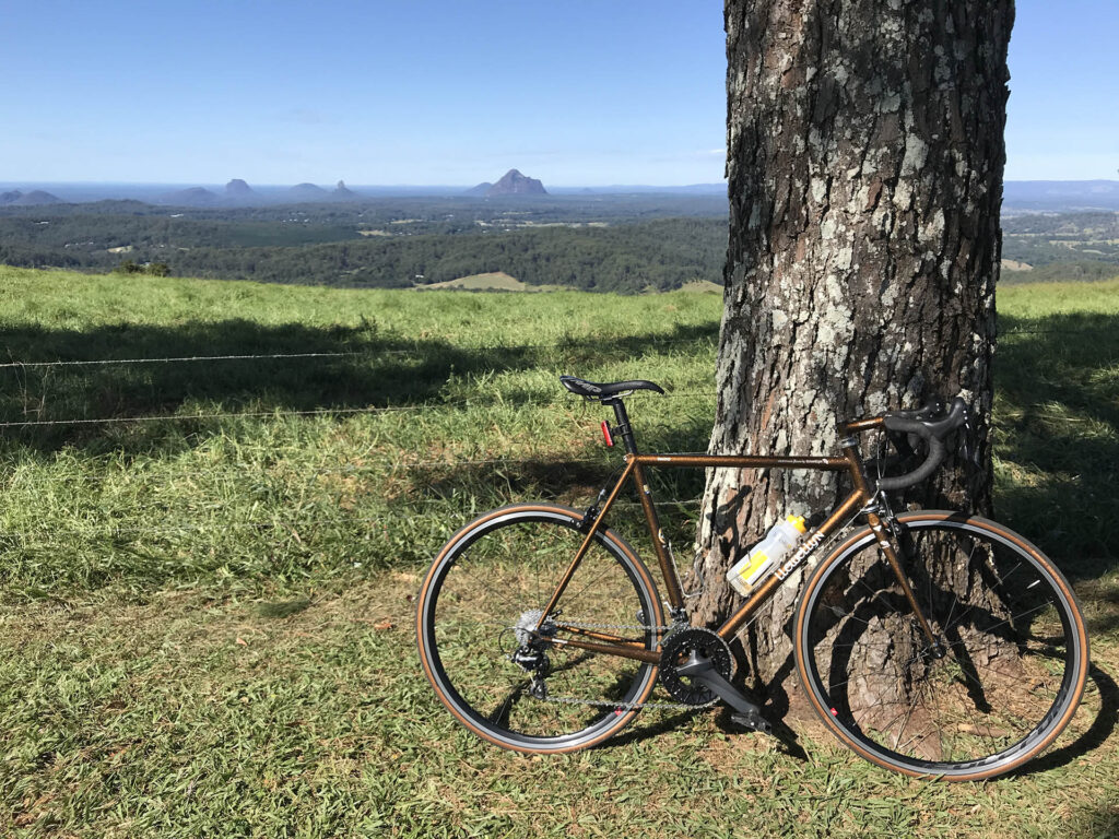 bicycle tour with a view of the Glasshouse Mountains on the Sunshine Coast, Queensland